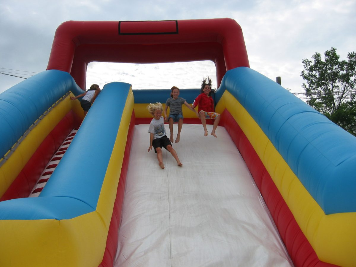 3 kids sliding down the Giant slider